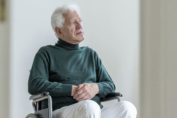 Kranker Lokführer im Rollstuhl